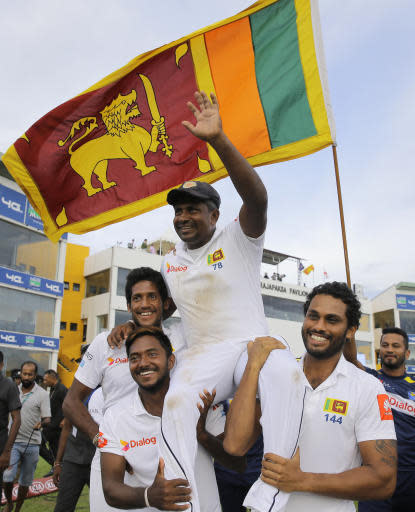 Sri Lankan cricket team members carry their bowler Rangana Herath who played his career last test cricket match on after the fourth day's play of the first test cricket match between Sri Lanka and England in Galle, Sri Lanka, Friday, Nov. 9, 2018. (AP Photo/Eranga Jayawardena)