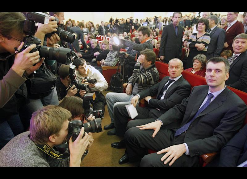 Mikhail Prokhorov, Russian billionaire and New Jersey Nets owner, right, attends a meeting with supporters who nominated him for the Presidential election in Moscow, Russia, Thursday, Dec. 15, 2011. Prokhorov said his first move if elected will be to pardon jailed tycoon Mikhail Khodorkovsky. (AP Photo/Misha Japaridze)