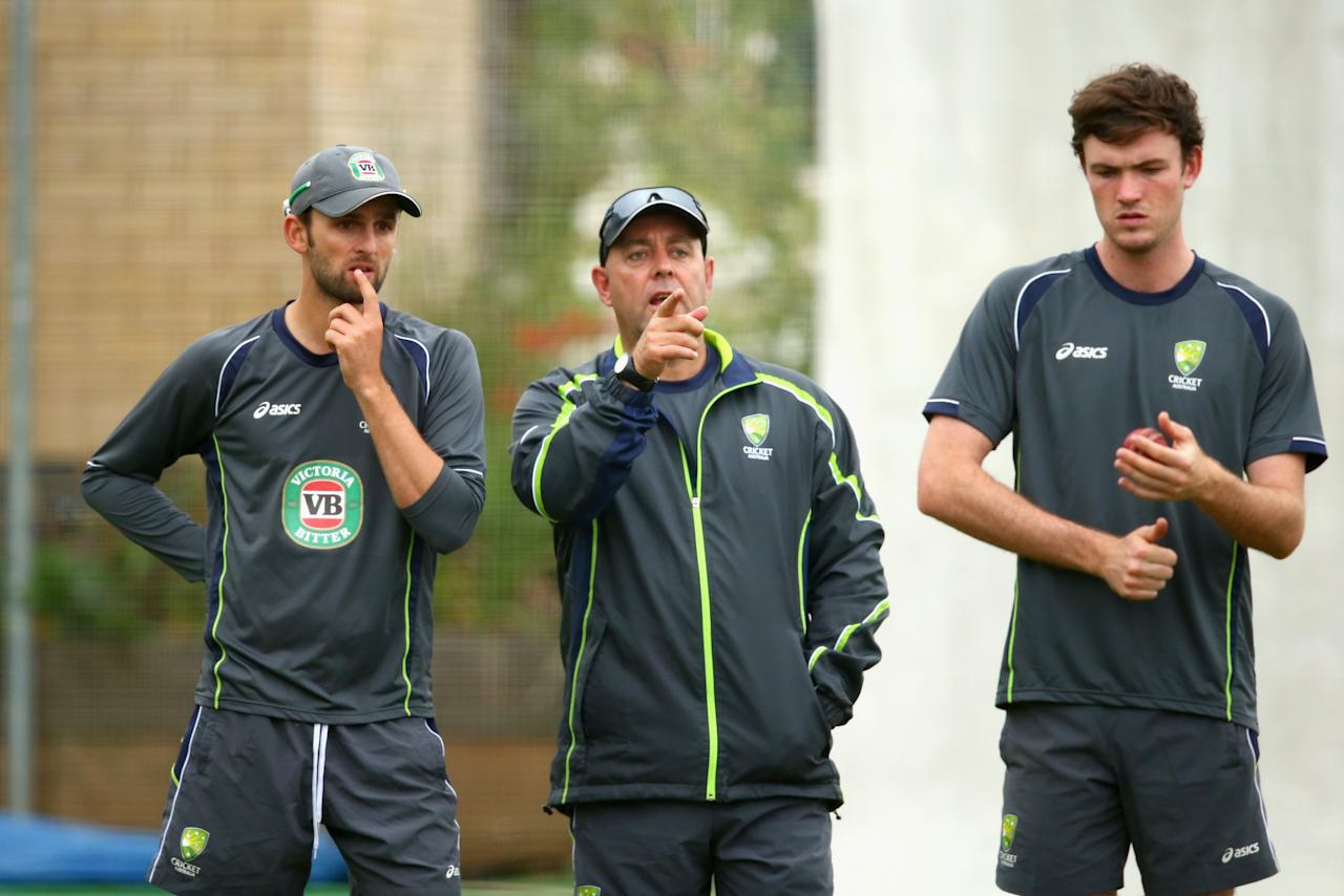 BRIGHTON, ENGLAND - JULY 25:  Nathan Lyon of Australia , Darren Lehmann, coach of Australia, and Ashton Turner of Australia looks on during an Australian Training Session at The County Ground on July 25, 2013 in Brighton, England.  (Photo by Ryan Pierse/Getty Images)