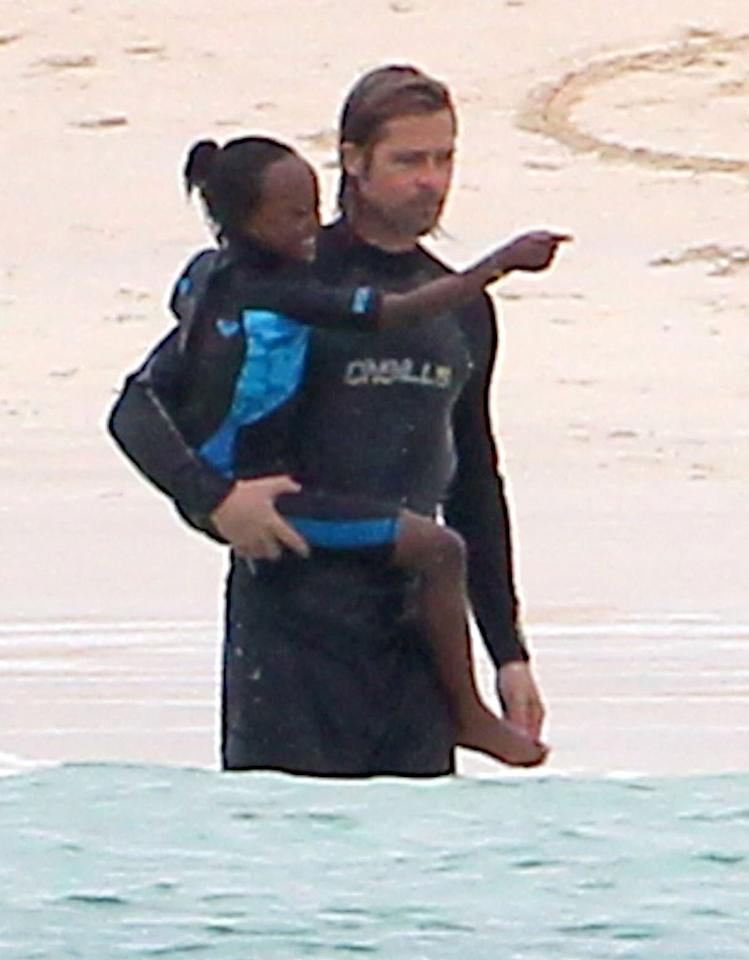 Out in the water, Papa Pitt gave his 7-year-old daughter Zahara a lift as the wetsuit-clad pair stood in the ocean. (4/20/2012)