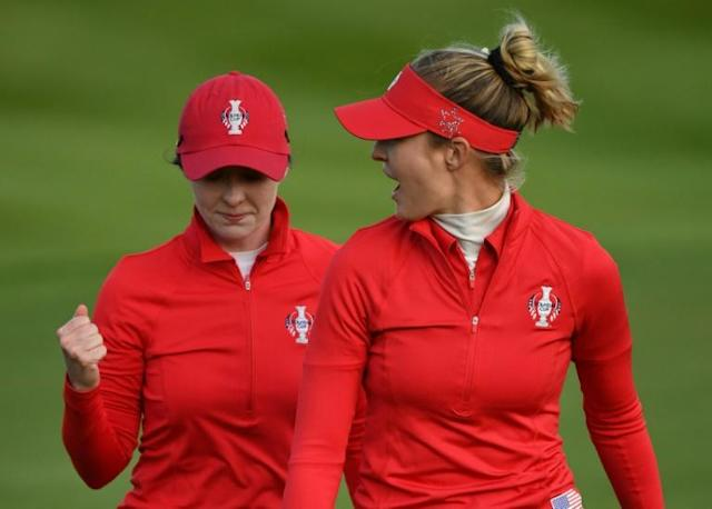 USA's Brittany Altomare (left) holed a key putt on the 18th to keep Europe's Solheim Cup lead at just one point (AFP Photo/ANDY BUCHANAN)
