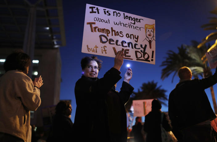 <p>Alisa McAffee holds up a sign during a demonstration in support of special counsel Robert Mueller, Thursday, Nov. 8, 2018, in Las Vegas, Nev. (Photo: John Locher/AP) </p>