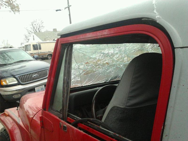 This Jan. 15, 2014, photograph provided by Donald Wilkes, 61, of Spokane, Wash., shows damage to a Jeep caused by the explosion of what police described as a firecracker inside. The vehicle was driving in north Spokane when the explosion occurred, blowing off the driver's left hand and prompting fears about his initial intent. The Jeep came to a stop in front of Wilkes' home. (AP Photo/Courtesy of Donald Wilkes)