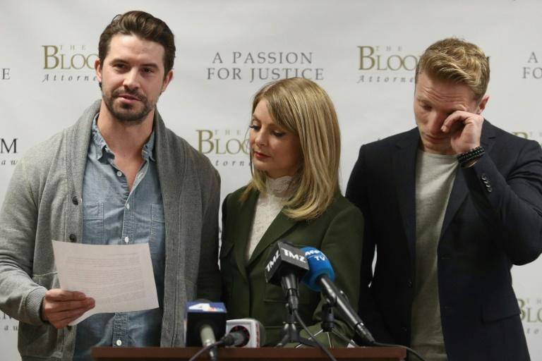 Model Mark Ricketson, left, speaks during a press conference with his attorney Lisa Bloom, center, and model Jason Boyce, who are accusing photographer Bruce Weber of sexual misconduct, in Woodland Hills, California on December 5, 2017