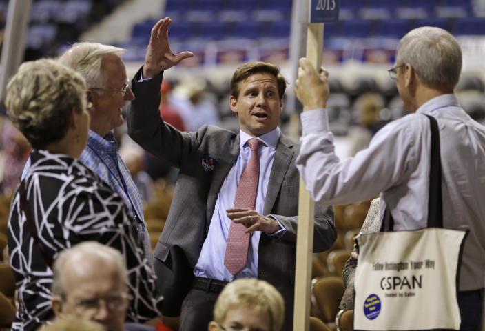 """FILE - In this May 17, 2013, file photo, candidate for Governor of Virginia, Pete Snyder, center, gestures as he talks to delegates during the opening of the Virginia Republican convention in Richmond, Va. Tens of thousands of Virginians are casting ballots to choose nominees for governor and other statewide offices. The Republican Party is holding what it's calling an """"unassembled convention"""" on Saturday, May 8, 2021, to select its nominees in this year's race for governor, lieutenant governor, and attorney general. Republicans haven't won a statewide race in Virginia since 2009. (AP Photo/Steve Helber, File)"""