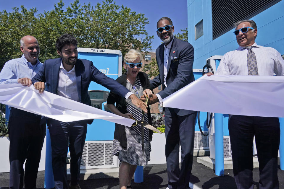 Timothy Cawley, president of Con Edison, left, Frank Reig, Revel founder and CEO, second from left, Secretary of Energy Jennifer Granholm, center, Councilman Robert Cornegy, Jr., second from right, and Mike Calise, Americas president of Tritium, cut the ribbon at an opening ceremony for an electric vehicle charging hub in the Brooklyn borough of New York, Tuesday, June 29, 2021. Granholm is visiting the state to promote President Joe Biden's sweeping infrastructure plan. (AP Photo/Seth Wenig)