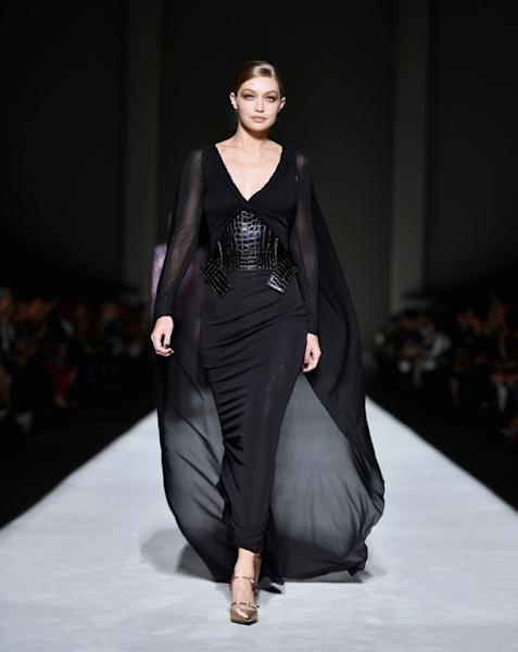 US model Gigi Hadid walks the runway at the New York Fashion Week