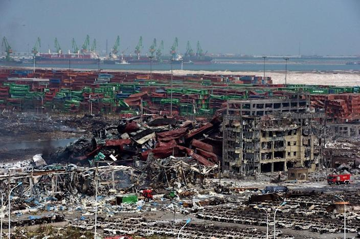 Mangled cargo containers and twisted wreckage at the site of the explosions in Tianjin in August 2015 (AFP Photo/STR)