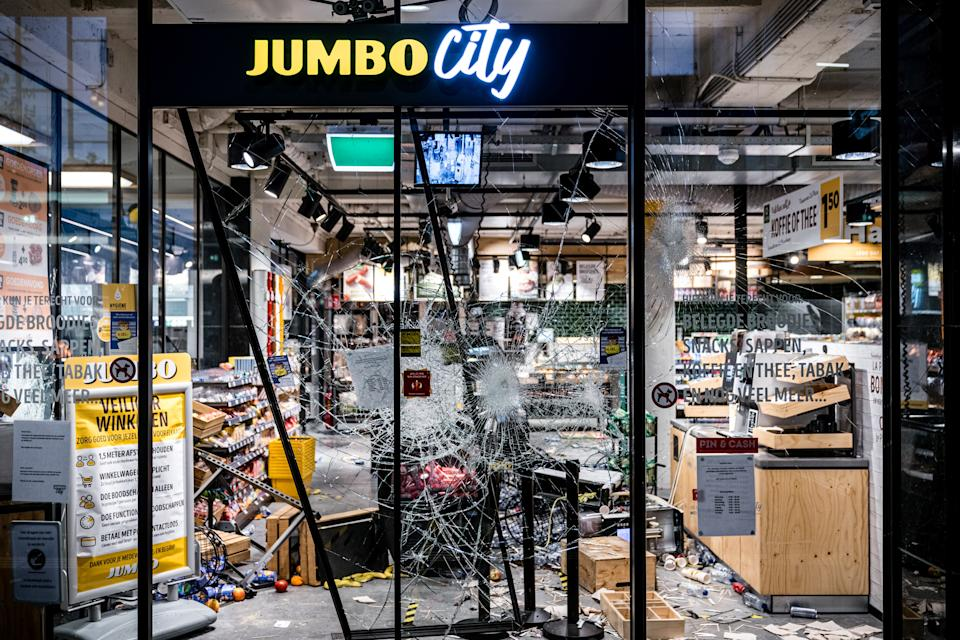 A store has been damaged near the train station, on January 24, 2021 in Eindhoven, after a rally by several hundreds of people against the corona policy. (Photo by ROB ENGELAAR / various sources / AFP) / Netherlands OUT (Photo by ROB ENGELAAR/ANP/AFP via Getty Images)
