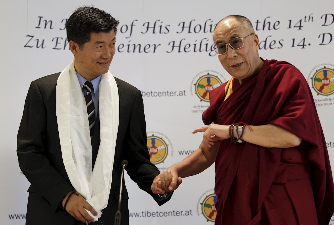 Tibet's exiled spiritual leader the Dalai Lama (R) and Lobsang Sangay, Prime Minister of the Tibetan government-in-exile, arrive for a news conference in Vienna, Austria, May 25, 2012. REUTERS/Leonhard Foeger/File Photo TPX IMAGES OF THE DAY