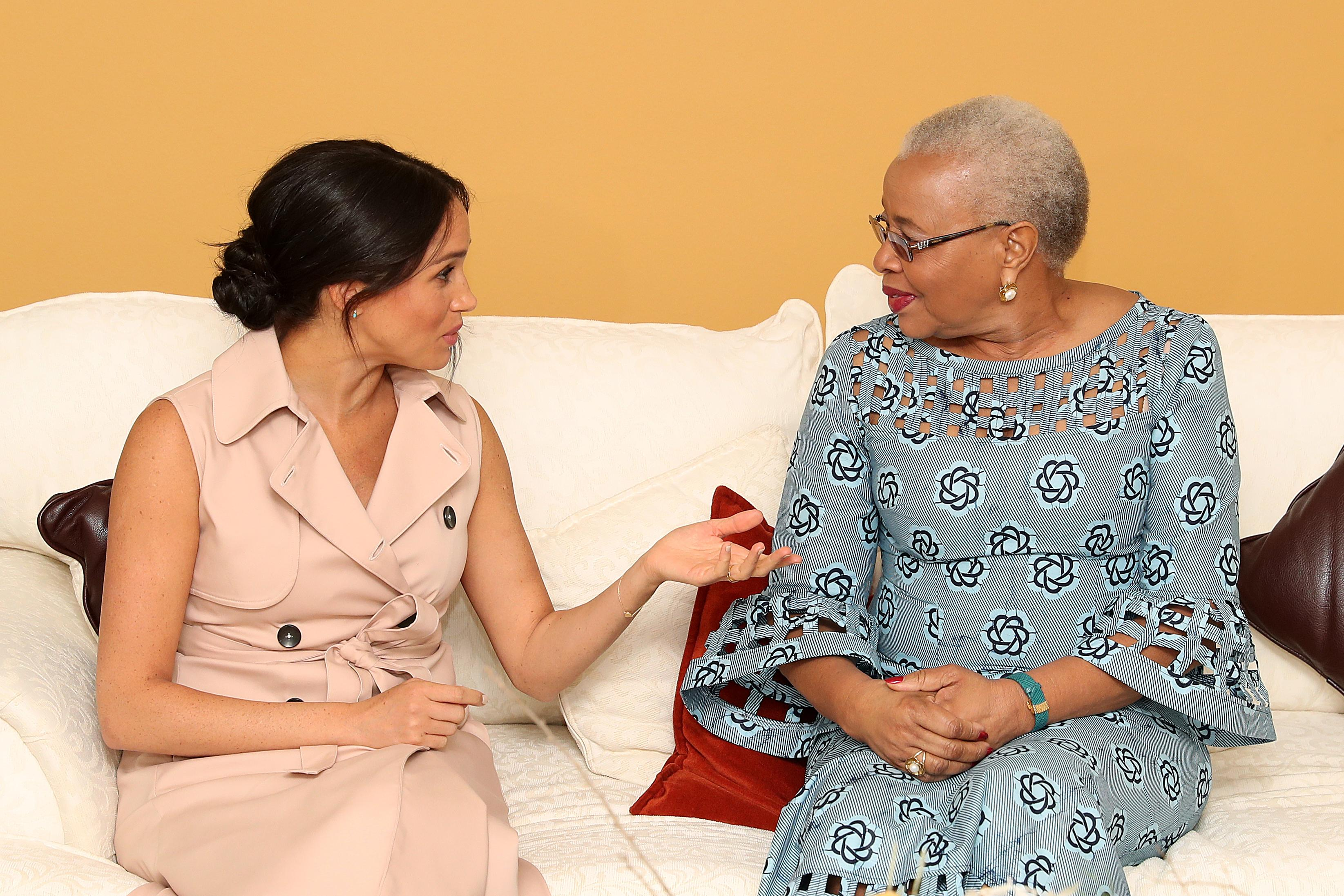 JOHANNESBURG, SOUTH AFRICA - OCTOBER 02: Meghan, Duchess of Sussex speaks to Graca Machel, widow of the late Nelson Mandela on October 02, 2019 in Johannesburg, South Africa. The Duke last met with Mrs Machel during his visit to South Africa in 2015. (Photo by Chris Jackson-Pool/Getty Images)