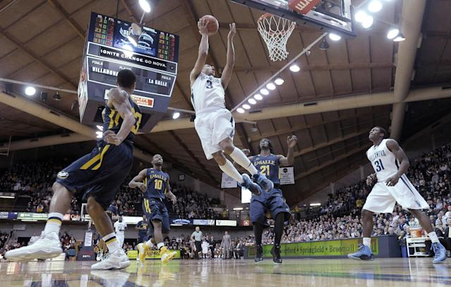 Villanova's Josh Hart (3) shoots a basket in front of La Salle's Tyrone Garland (21) and Sam Mills (10) during the first half of an NCAA college basketball game on Sunday, Dec. 15, 2013, in Villanova, Pa. (AP Photo/Michael Perez)