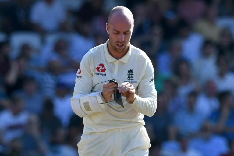 England's Jack Leach cleans his glasses during a break in play as he helped Ben Stokes to his match-winning innings (AFP Photo/Paul ELLIS)