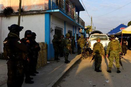 Policemen and soldiers guard a crime scene where mayoral candidate Santana Cruz Bahena was gunned down at his home in the municipality of Hidalgotitlan, in the state of Veracruz, Mexico November 20, 2017. REUTERS/Angel Hernandez