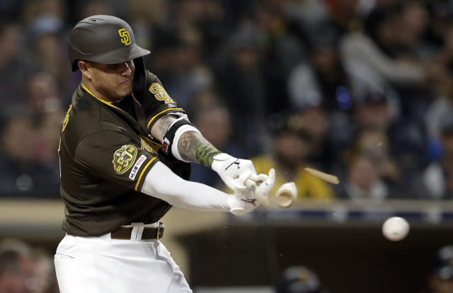 San Diego Padres' Manny Machado breaks his bat as he hits into a double play during the third inning of the team's baseball game against the Pittsburgh Pirates, Friday, May 17, 2019, in San Diego. (AP Photo/Gregory Bull)