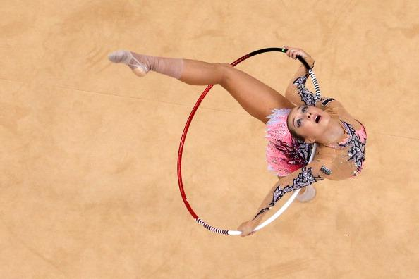 LONDON, ENGLAND - AUGUST 11:  Liubou Charkashyna of Belarus competes during the Individual All-Around Rhythmic Gymnastics final on Day 15 of the London 2012 Olympics Games at Wembley Arena on August 11, 2012 in London, England.  (Photo by Richard Heathcote/Getty Images)