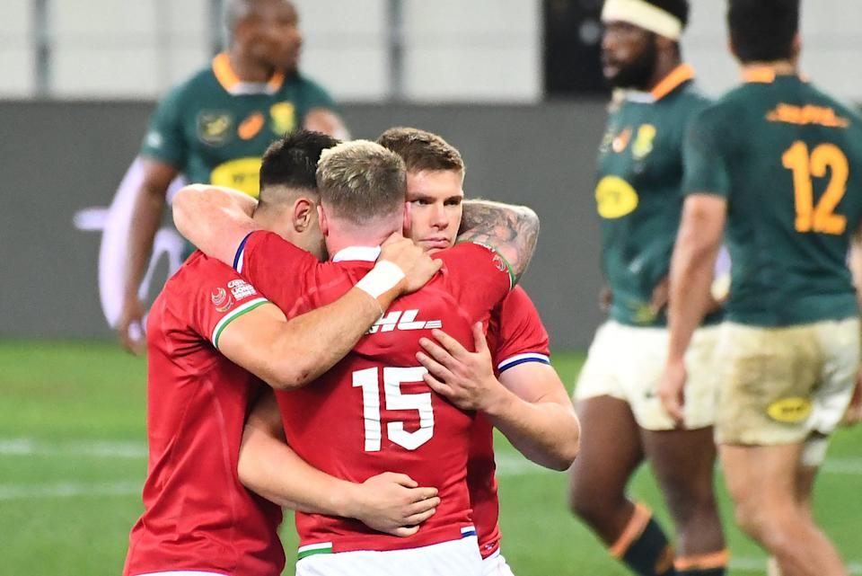 The Lions celebrate their dramatic First Test win over South Africa in Cape Town (AFP via Getty Images)