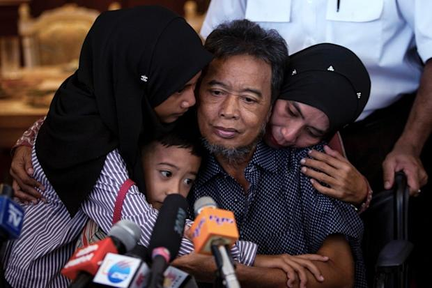 Tayudin Anjut(centre), who was rescued by the Philippine security forces on Thursday, arrived at the KL International Airport (KLIA) in Sepang last night. — File pic