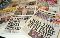 British newspaper headlines lamented tighter restrictions over the Christmas holidays