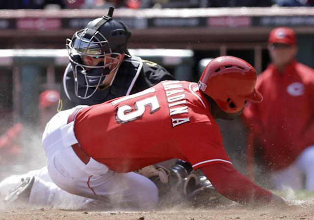 Cincinnati Reds' Roger Bernadina (15) is tagged out at home by Pittsburgh Pirates catcher Tony Sanchez in the eighth inning of a baseball game, Wednesday, April 16, 2014, in Cincinnati. Cincinnati won 4-0. (AP Photo/Al Behrman)