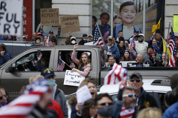 FILE - In this April 20, 2020, file photo, protesters demonstrate at the state Capitol in Harrisburg, Pa., demanding that Gov. Tom Wolf reopen Pennsylvania's economy even as new social-distancing mandates took effect at stores and other commercial buildings. Many African Americans watching protests calling for easing restrictions meant to slow the spread of the new coronavirus see them as one more example of how their health and their rights just don't seem to matter. (AP Photo/Matt Slocum, File)