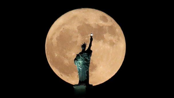 PHOTO: A supermoon rises in front of a replica of the Statue of Liberty sitting atop the Liberty Building in downtown Buffalo, N.Y., Dec. 3, 2017. (Julio Cortez/AP)