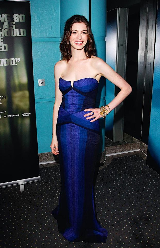 """Anne Hathaway is beyond beautiful in a blue and amethyst strapless ombre column gown from Zac Posen's latest collection. Jon Furniss/<a href=""""http://www.wireimage.com"""" target=""""new"""">WireImage.com</a> - October 20, 2008"""