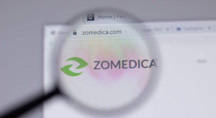 A magnifying glass zooms in on the website for Zomedica (ZOM).