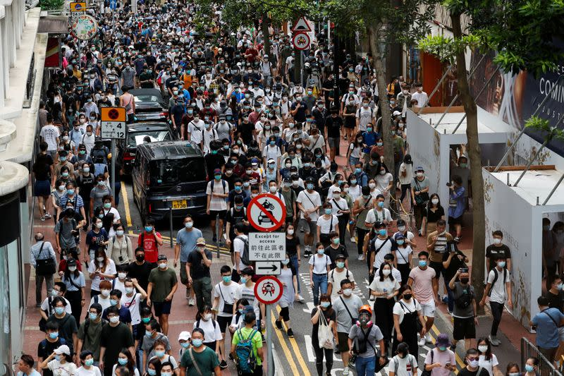 FILE PHOTO: Anti-national security law protesters march at the anniversary of Hong Kong's handover to China from Britain, in Hong Kong