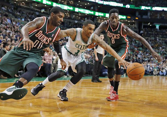 Boston Celtics' Courtney Lee (11) battles Milwaukee Bucks' O.J. Mayo (00) and Larry Sanders (8) for a loose ball in the first quarter of an NBA basketball game in Boston, Friday, Nov. 1, 2013. (AP Photo/Michael Dwyer)