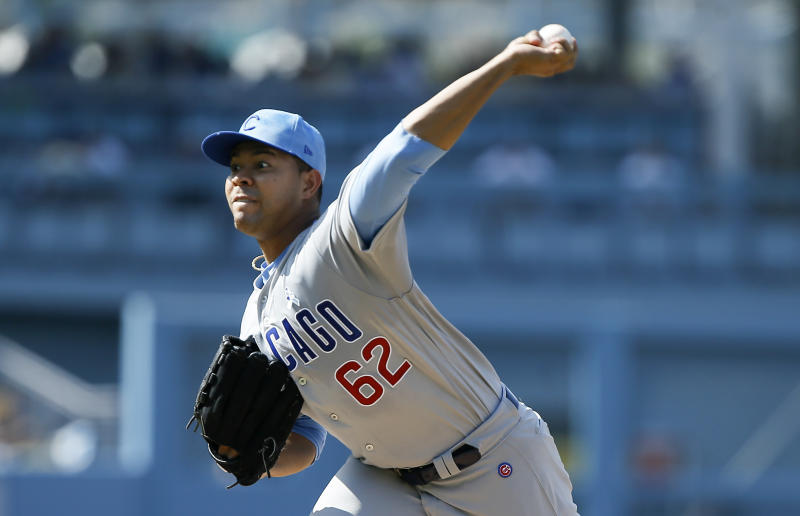 Chicago Cubs starting pitcher Jose Quintana throws to a Los Angeles Dodgers batter during the first inning of a baseball game in Los Angeles, Sunday, June 16, 2019. (AP Photo/Alex Gallardo)