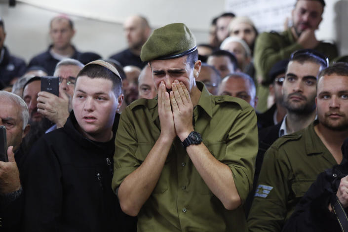 Soldiers and friends of Israeli soldier Yosef Cohen mourn during his funeral in Jerusalem, Friday, Dec. 14, 2018. Cohen was one of two Israeli soldiers killed by Palestinian gunman in the West Bank Thursday. (AP Photo/Ariel Schalit)