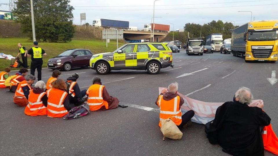 Around 20 protesters blocked the junction to St Clements Way and London Road, in Thurrock (Insulate Britain/PA) (PA Media)