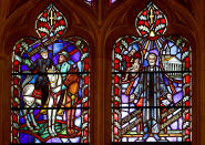 FILE - This Wednesday, Sept. 6, 2017 file photo shows stained glass windows depicting two Confederate generals at the Washington National Cathedral. Washington National Cathedral has chosen contemporary artist Kerry James Marshall, renowned for his wide-ranging works depicting African-American life, to design new stained-glass windows with themes of racial justice to replace windows with Confederate imagery that were removed from the landmark sanctuary in 2017. (AP Photo/Carolyn Kaster)