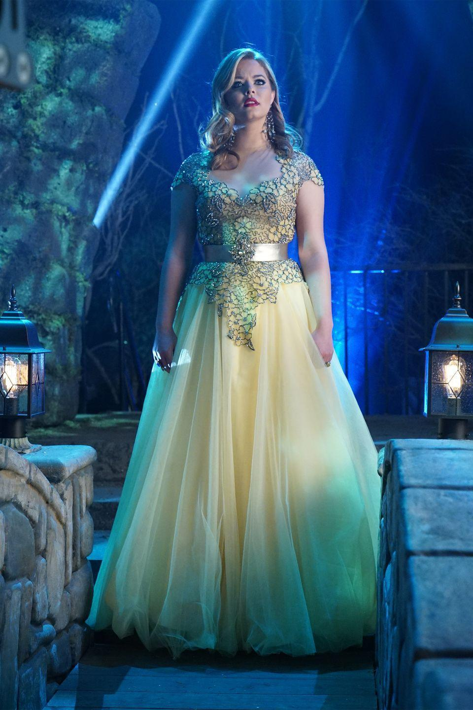 """<p>While the entire crew at Rosewood High School looked amazing on prom night, Alison was the belle of the ball in this cream gown, complete with loose curls and a red lip. </p><p> <a class=""""link rapid-noclick-resp"""" href=""""https://www.amazon.com/Pretty-Little-Liars-Complete-Season/dp/B003Q93YBO?tag=syn-yahoo-20&ascsubtag=%5Bartid%7C10063.g.36197518%5Bsrc%7Cyahoo-us"""" rel=""""nofollow noopener"""" target=""""_blank"""" data-ylk=""""slk:STREAM NOW"""">STREAM NOW</a></p>"""