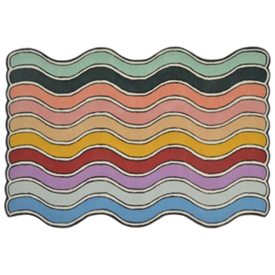"<h2>The Wavy Rug Brite Hand Tufted Carpet</h2><br>Why yes, this rug does cost an eyewatering $1,800 — but it is mesmerizing and we felt compelled to share. Revel in its funky rainbow beauty with us. <br><br><em>Shop <strong><a href=""https://www.1stdibs.com/furniture/rugs-carpets/area-rugs-carpets/wavy-rug-brite-hand-tufted-carpet/id-f_18424422/"" rel=""nofollow noopener"" target=""_blank"" data-ylk=""slk:1stDibs"" class=""link rapid-noclick-resp"">1stDibs</a></strong></em><br><br><br><br><strong>The Wavy Rug</strong> Wavy Rug Brite Hand Tufted Carpet, $, available at <a href=""https://go.skimresources.com/?id=30283X879131&url=https%3A%2F%2Fwww.1stdibs.com%2Ffurniture%2Frugs-carpets%2Farea-rugs-carpets%2Fwavy-rug-brite-hand-tufted-carpet%2Fid-f_18424422%2F"" rel=""nofollow noopener"" target=""_blank"" data-ylk=""slk:1st Dibs"" class=""link rapid-noclick-resp"">1st Dibs</a>"