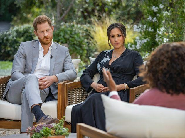 Prince Harry and Meghan Markle, the Duke and Duchess of Sussex, sit down for an interview with Oprah Winfrey. (Photo: CBS)