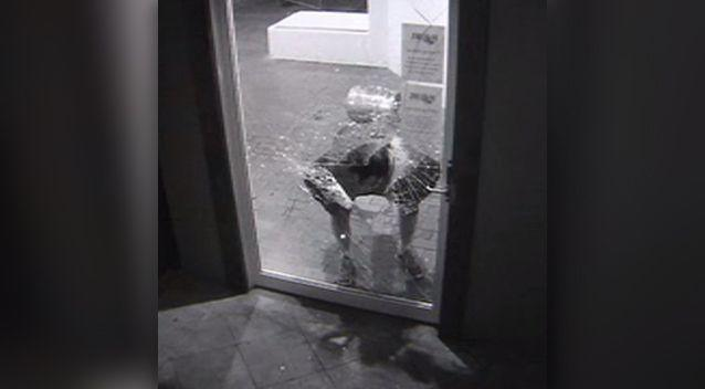 After smashing a hole in the door with the keg, the man embarks on his first attempt to get inside. Photo: Supplied