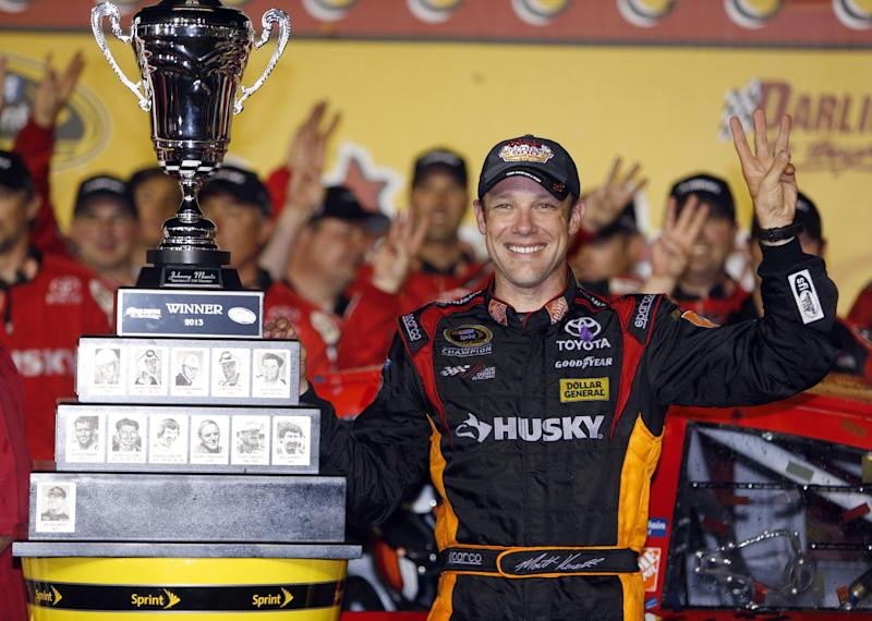 Matt Kenseth celebrates in Victory Lane and holds up three fingers to signify his third win this year after, after he won the NASCAR Sprint Cup series auto race at Darlington Raceway, Saturday, May 11, 2013, in Darlington, S.C. †(AP Photo/Mic Smith)