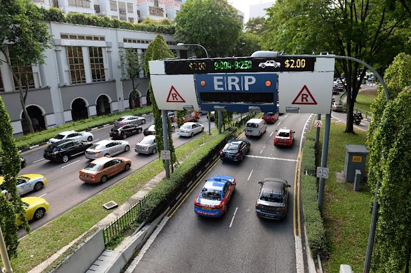 Singapore already imposes a quota on the number of vehicles sold and the number on its roads, and has avoided the massive traffic jams that choke other Asian cities (AFP Photo/ROSLAN RAHMAN)