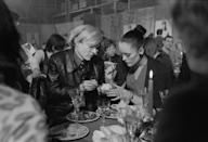 <p>Andy Warhol and actress and model Jane Forth attend the party for the premiere of the movie 'Trash' on February 19, 1971 in Munich, West Germany.</p>