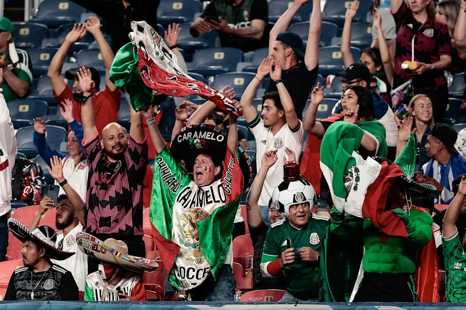 Mexico fans react in the second half against Costa Rica during the semifinals of the 2021 CONCACAF Nations League soccer series at Empower Field at Mile High.