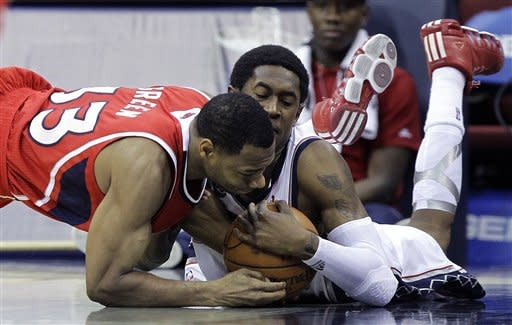 Atlanta Hawks' Willie Green, left, and New Jersey Nets' MarShon Brooks, right, compete for the ball in the second quarter of an NBA basketball game, Monday, Jan. 9, 2012, in Newark, N.J. (AP Photo/Julio Cortez)