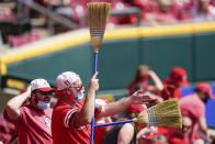 Cincinnati Reds' fans celebrate during the eighth inning of a baseball game against the Pittsburgh Pirates at Great American Ball Park in Cincinnati, Wednesday, April 7, 2021. (AP Photo/Bryan Woolston)