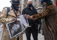 A vendor distributes a printed tribute to the late Cicely Tyson as people arrive for a public viewing at the Abyssinian Baptist Church in the Harlem neighborhood of New York Monday, Feb. 15, 2021. Tyson, the pioneering Black actress died on Jan. 28. (AP Photo/Craig Ruttle)