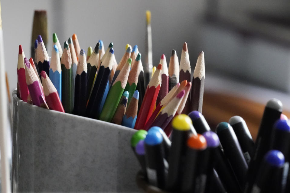 """Colored pencils, sharpened and at the ready, rest in a container on the desk of artist Robert Seaman in his room at an assisted living facility Monday, May 10, 2021, in Westmoreland, N.H. Seaman, who moved into the facility weeks before the COVID-19 pandemic shutdown his outside world in 2020, recently completed his 365th daily sketch, or what he calls his """"Covid Doodles"""", since being isolated due to the virus outbreak. (AP Photo/Charles Krupa)"""