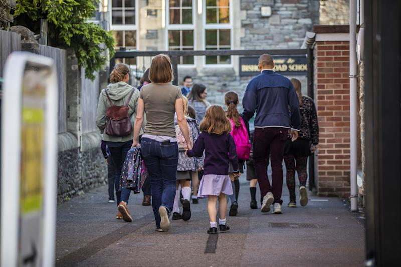 Parents walk their children into Bishop's Road Primary School as schools reopen. Bristol. 1 September 2020. See SWNS story SWBRschool. Many schools are returning in full for the first time since March.