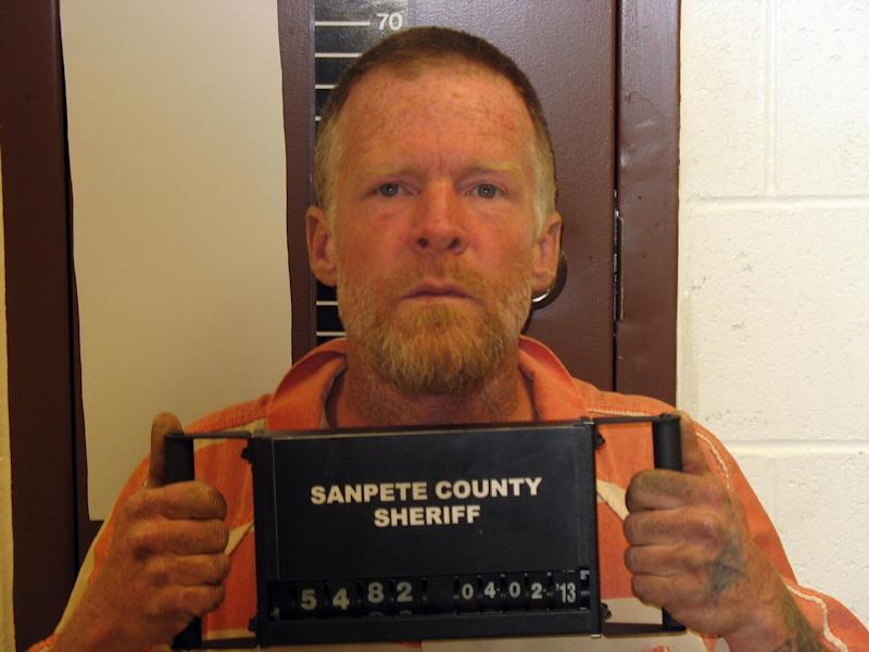 """FILE - This photo released by the Sanpete County Sheriff's Office shows Troy James Knapp.  On April 2, 2013, authorities captured Knapp, an elusive survivalist who is suspected of burglarizing Utah cabins and leaving some covered with threats and bullet holes, ending a saga that began six years ago and drew in police and residents around the state. Knapp, dubbed the """"Mountain Man"""" by cabin owners, was taken into custody in the snowy mountains outside of Ferron in central Utah after firing several shots at officers in a helicopter, authorities said.(AP Photo/Sanpete County Sheriff's Office )"""