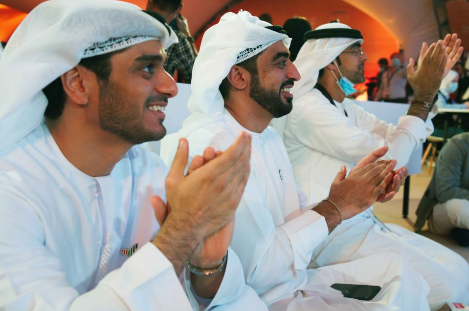 "Emirati men claps as they watch the launch of the ""Amal"" or ""Hope"" space probe at the Mohammed bin Rashid Space Center in Dubai, United Arab Emirates, Monday, July 20, 2020. A United Arab Emirates spacecraft, the ""Amal"" or ""Hope"" probe, blasted off to Mars from Japan early Monday, starting the Arab world's first interplanetary trip. (AP Photo/Jon Gambrell)"