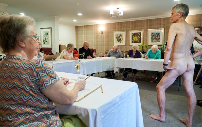 Care home residents enjoyed prosecco as they did their pencil sketches. [Photo: Simon Jacobs]